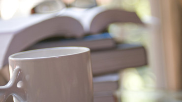 15973-a-cup-of-coffee-with-a-stack-of-books-pv-2